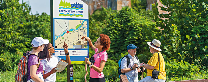 groups of people consulting trail map