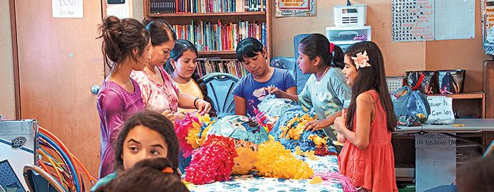 students stuffing pinatas